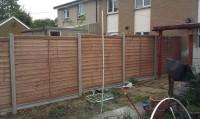 lapped panels & concrete posts & gravel boards